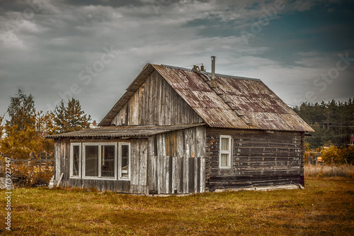 Old dilapidated ancient wooden wooden house in the village