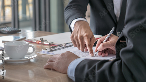 Fototapeta The selective and soft focused image of businessman is going to sign the contract in the business meeting. obraz