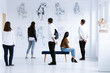 Leinwanddruck Bild - Visitors in art gallery