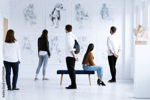 Visitors in art gallery
