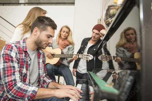Group of friends playing music - 173995817