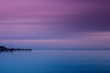Fishing dock in calm sea and smooth sky