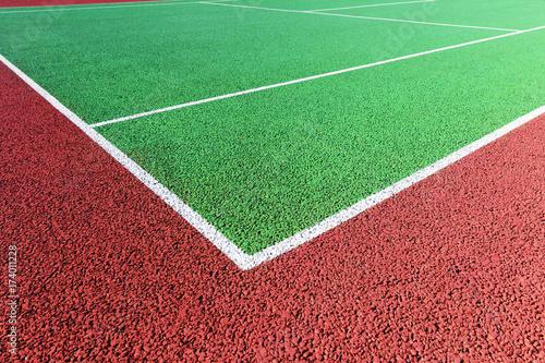 Photo  Baseline on green hard tennis court
