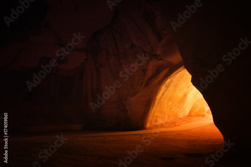 Fotografia, Obraz image of beautiful golden light through the cave entrance