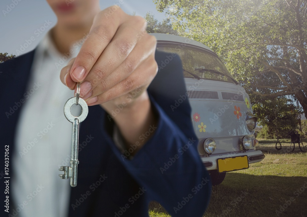 Businesswoman Hand Holding key in front of camper van Poster ...