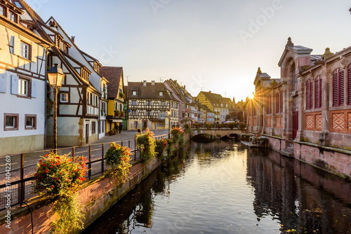 Fotobehang Praag Beautiful view of the historic town of Colmar, also known as Little Venice, boat ride along traditional colorful houses on idyllic river Lauch in summer, Colmar, Alsace, France