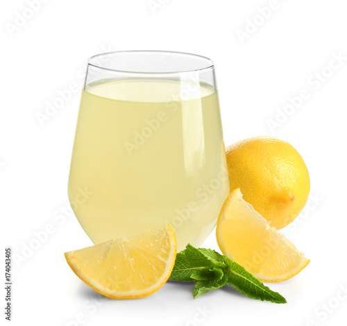 Glass of fresh lemon juice on white background