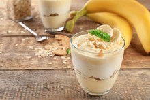 Glass With Delicious Banana Pudding On Table