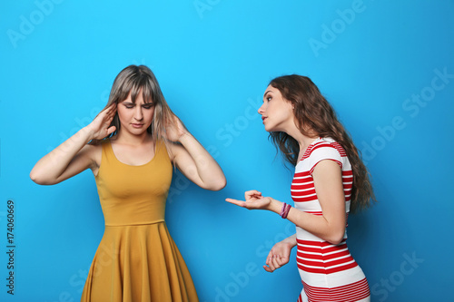 Two young woman having an argue Canvas Print