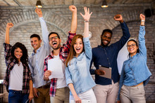Group Of Young Businesspeople Celebrating Success