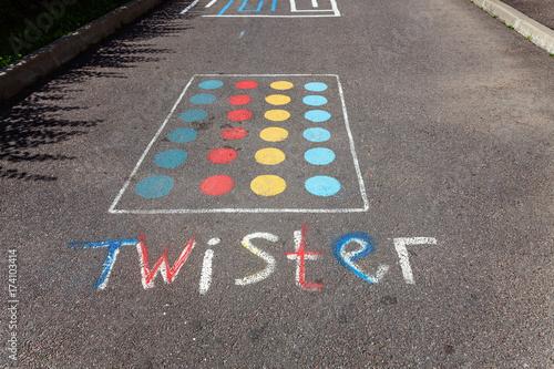 Fotografie, Obraz  children's game twister on the asphalt