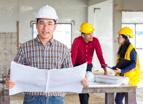 Group of engineerarchitectworker man and woman discussing about group of engineerarchitectworker man and woman discussing about building plan for construction malvernweather Image collections