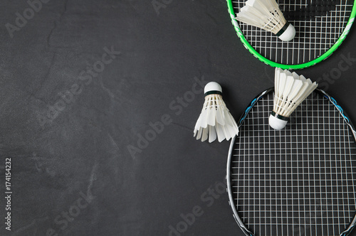 Shuttlecocks and badminton racket on black background. Canvas Print