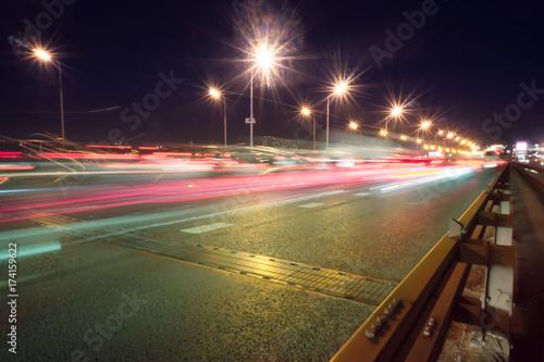 Foto op Aluminium Nacht snelweg Speed motion,abstract background rays.Traffic car lights on road.