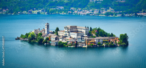 Deurstickers Eiland The island of San Giulio by the Italian lake - lago d'Orta, Piemonte, Italy.