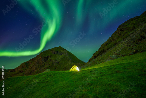 Illuminated tent in Norway with the northern lights overhead Canvas-taulu