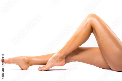 Fototapeta Long beauty pretty woman legs isolated on white. obraz na płótnie