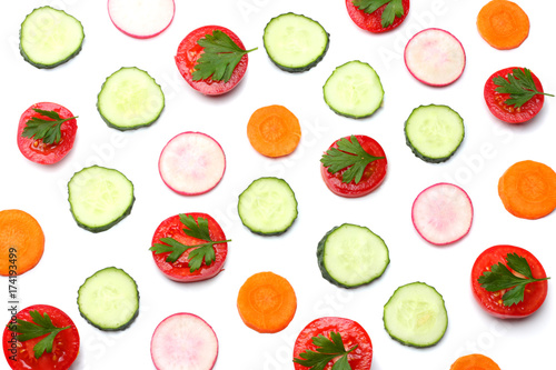 Fototapety, obrazy: mix of sliced cucumber with sliced carrot and tomato isolated on a white background top view