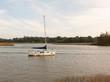 single private boat moored in river high tide landscape scene