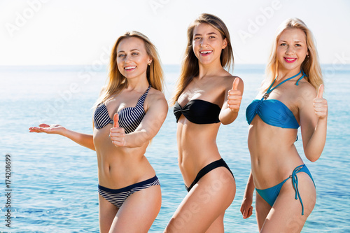 40befad2501 Portrait of three cheerful young women on beach - Buy this stock ...