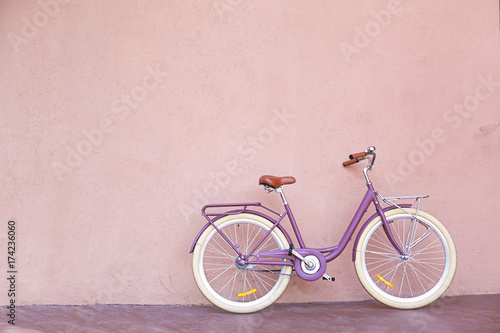 Tuinposter Fiets Stylish new bicycle near color wall outdoors