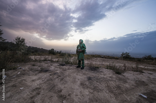 Foto op Canvas Jacht man in a gas mask in a polluted city,stalker