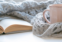 Cozy Home Still Life: Cup Of Hot Coffee And Opened Book With Warm Plaid On Windowsill Against Snow Landscape Outside. Winter Holidays, Christmas Time Concept, Free Copy Space