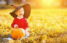 Baby Boy With Pumpkin Outdoors...