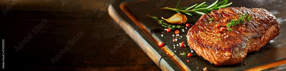 Fototapety, obrazy: Piece of rump steak on cutting board