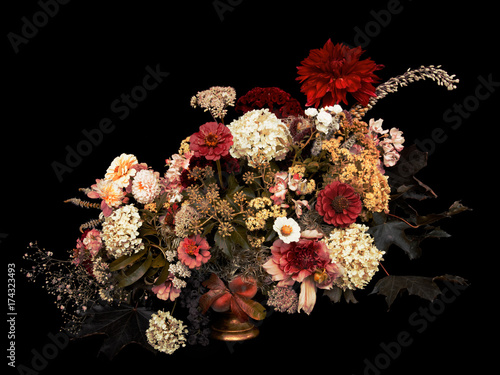 Fotobehang Bloemen Floral arrangement, autumn bouquet, on black background. Toned image.