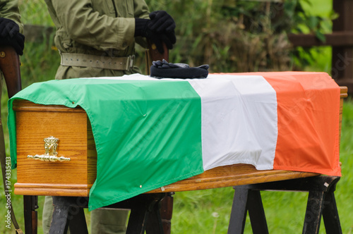 ira paramilitary gloves and beret on a coffin with an irish