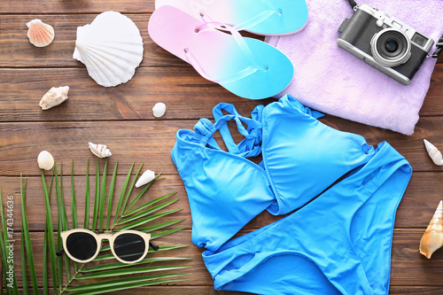 Composition with swimsuit on wooden background. Summer vacation concept