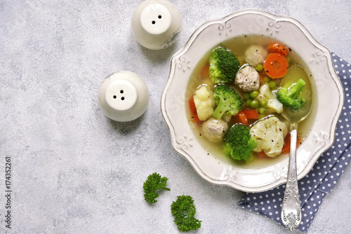 Soup with meatballs and vegetables.Top view with space for text.