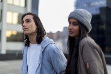 Young Mixed Race Couple On Rooftop Chatting