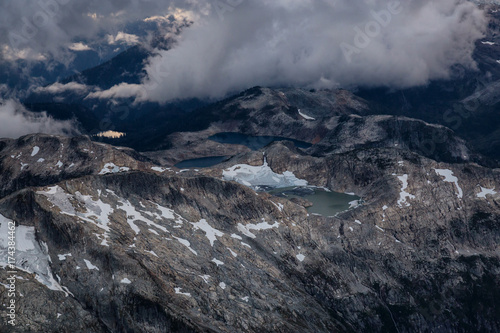 Canvas Prints Dragons Beautiful aerial landscape view of snow covered mountains with a colorful morning sky. Picture taken of Black Tusk in Garibaldi, British Columbia, Canada.