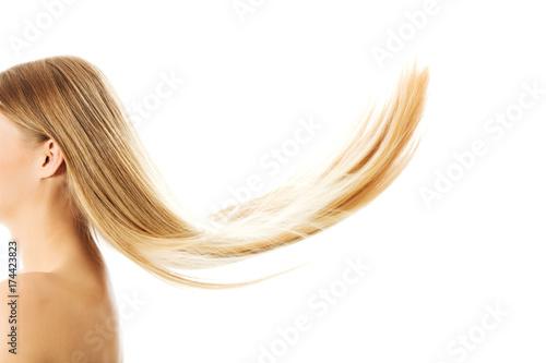 Obraz na plátně  Beautiful long blonde hair, isolated on white.
