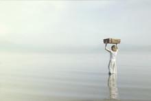 Dreamer Woman Walking Towards The Infinite In The Sea