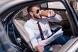 businessman drinking coffee in car