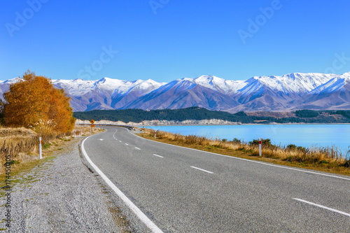 Canvas Prints New Zealand Scenic Road along Lake Tekapo at beautiful sunny morning . .Lake Tekapo and mountains with snow in autumn, Canterbury, South Island, New Zealand.