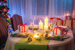 Gorgeous Christmas table setting with candles and gingerbread
