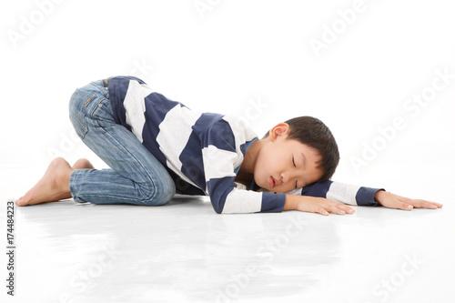 Asian cute boy sleeping while lay down