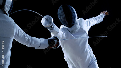 Fotomural  Two Professional Fencers Show Masterful Swordsmanship in their Foil Fight