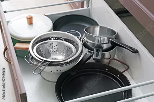 Set of kitchen utensils in drawer Wallpaper Mural