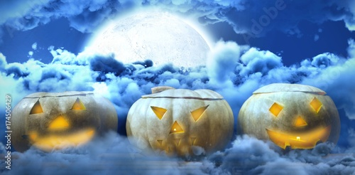 Composite image of jack o lanterns arranged on table Plakat