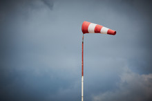 Windsock Blown By The Wind With Overcast Sky