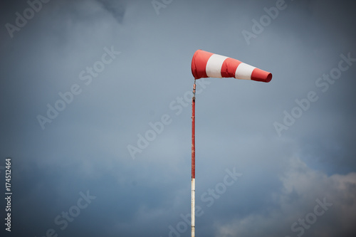 Foto Windsock blown by the wind with overcast sky