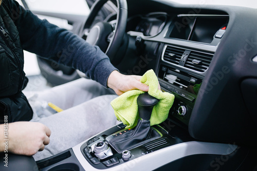 a man cleaning car interior car detailing or valeting concept