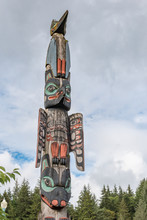 Totem Pole With Raven And Eagl...