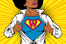 Pop Art Female Superhero. Young Sexy Afro American Woman Dressed In White Jacket Shows Superhero T-shirt With W Sign Means Woman On The Chest. Vector Illustration In Retro Pop Art Comic Style.