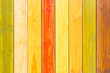 Multicolored wooden background from vertical smooth boards. Wood texture. Fence backdrop.